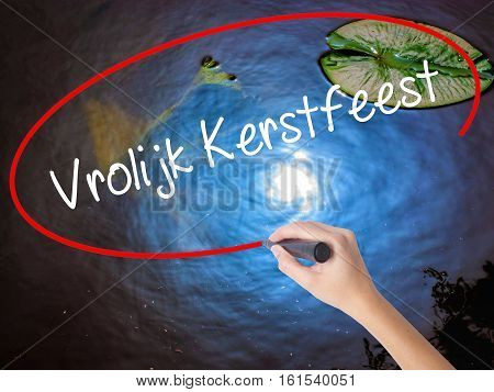 Woman Hand Writing Vrolijk Kerstfeest  (happy Christmas In Dutch) With Marker Over Transparent Board