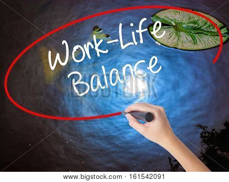 Woman Hand Writing Work-life Balance With Marker Over Transparent Board