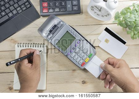 Cashier Made A Payment In Store Via Edc Or Credit Card Terminal And Author Bill Have Calculator, Clo