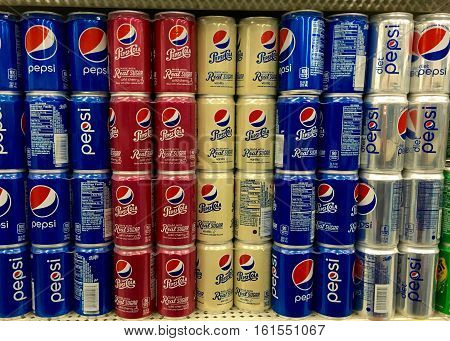 San Leandro CA - April 08 2016: Grocery Store shelf display with pepsi products. Pepsi Co is one of the largest corporations in the non-alcoholic beverage industry.