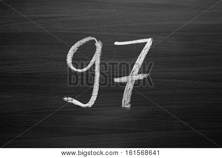 number ninety seven enumeration written with a chalk on the blackboard