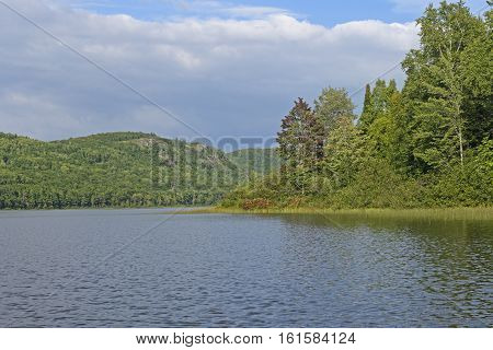 Forested Lake on a Sunny Day on Lake of the Clouds in Porcupine Mountains State Park in Michigan