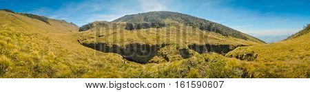 Panoramic photo of wild nature near Mt. Giluwe in Papua New Guinea. In this region one can only meet people from isolated local tribes.