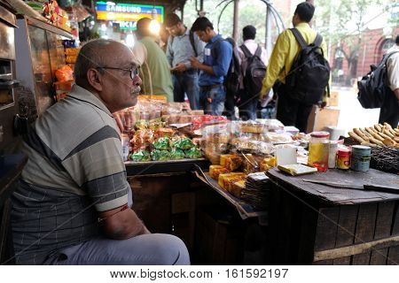 KOLKATA, INDIA - FEBRUARY 11: Street vendor in stall along a busy street in Kolkata, India on February 11, 2016.