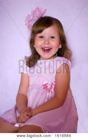 Laughting Happy Pink Little Girl