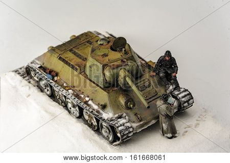 Legendary Soviet tank T-34 at war in the second world war. Diorama of winter view with officers