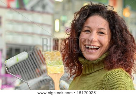Laughing Young Woman Selecting Diy Material