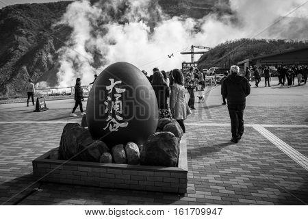 HAKONE, JAPAN - NOVEMBER 7, 2016: Tourists at the volcanic valley of Owakudani in Japan. Owakudani has many active sulphur vents and hot springs in Hakone, Japan.
