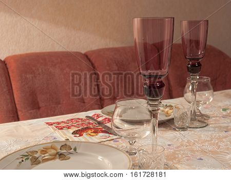 Tableware. Tall glass of champagne a glass of cognac a glass of vodka a plate