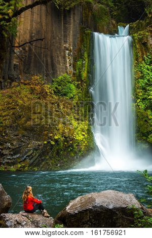 Tourist admiring Beautiful Toketee Falls Visiting Oregon
