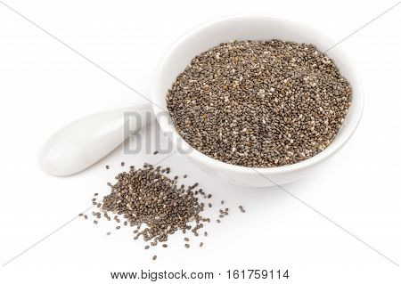 Healthy chia seeds isolated over a white background