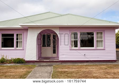 Tarraleah, Australia-February 9, 2013. Historic weatherboard cottages in the highlands township of Tarraleah, originally built as Hydro workers cottages in the 1930's, now tourist accommodation.