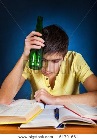 Tired Student with the Beer on the Blue Background