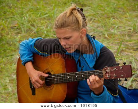 Hiker Girl Playing Guitar