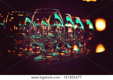 Glasses for alcohol. Glasses on a bar at the restaurant