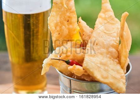 Snack to beer brushwood Chile served in a small iron bucket