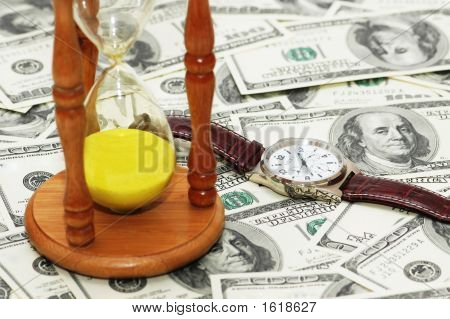 "Concept ""Time Is Money"" With Hourglass And Watch"