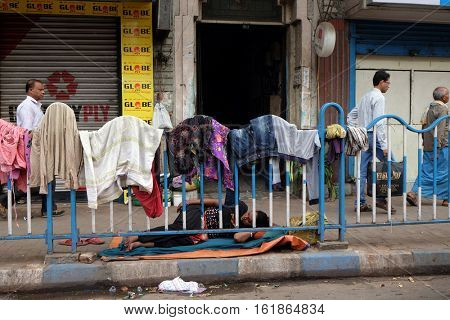 KOLKATA, INDIA - FEBRUARY 09: Homeless people sleeping on the footpath of Kolkata, India on February 09, 2016.