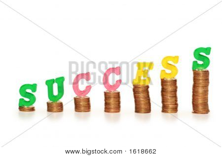 "Word ""Success"" On Top Of Coin Stacks"