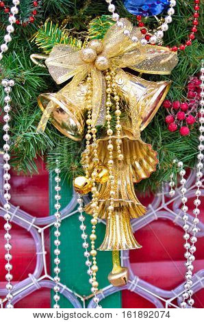 Branches Of A Christmas Tree Decorated With Jingle Bells. New Year Decoration.
