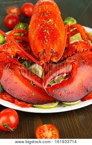 Big Red Lobster On A Platter With Green-stuff. Lobster On A Platter With Green-stuff As Fresh Seafoo