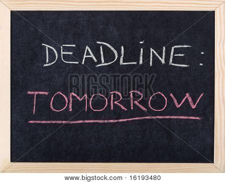 tomorrow deadline written on blackboard
