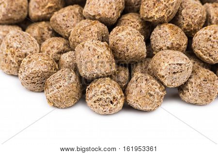 Close Up Of Extruded Rye Bran Isolated On White