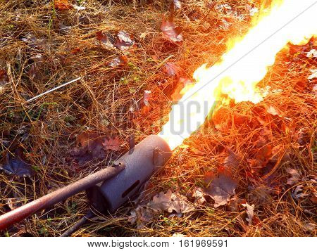 Flame gun/thrower after coil warmed up and flame roaring out of the front