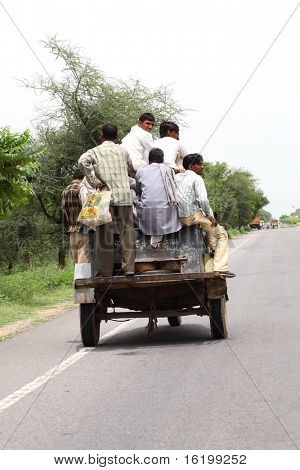 small open car with people
