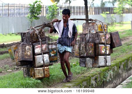 BOMBAY, INDIA - 30 JUNE 2008: The man is working as a porter. One of the most popular ways to earn money by poor people in India.