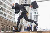 Motion Blur Of Businessman  Holding Bag And Running Rapidly To Airport In Formal Suit. In Rush Hour poster