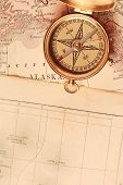 Antique Brass Compass Over Old Map poster