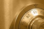 stock photo of combination lock  - Closeup of combination safe lock with golden tone - JPG