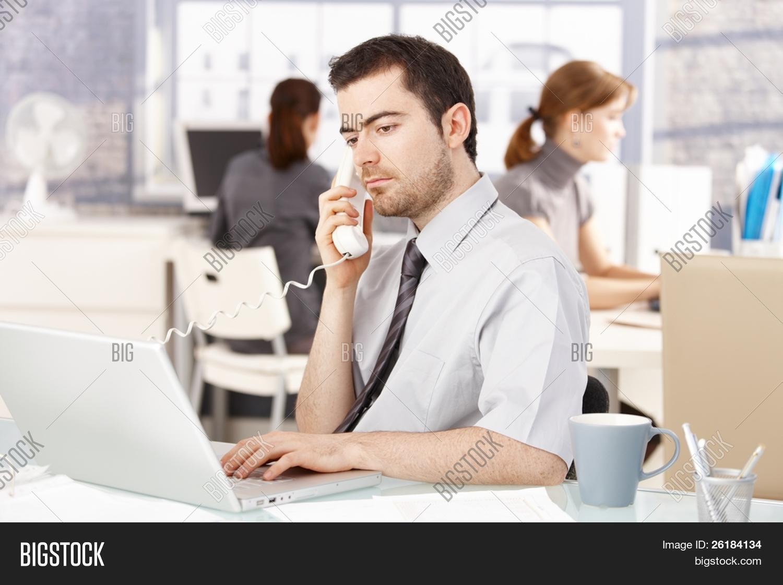imagen y foto joven oficinista sentado en el bigstock