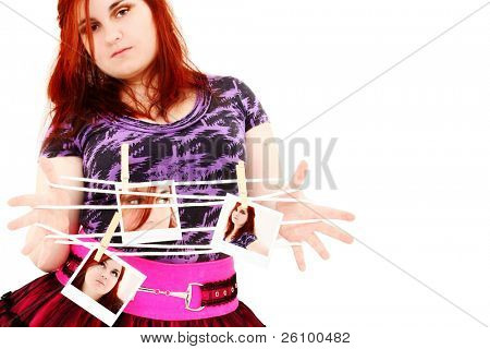 Beautiful 19 year old girl standing with photos of self over white background.