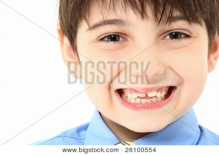 Adorable 7 year old french american boy close up in shirt and tie over white background.