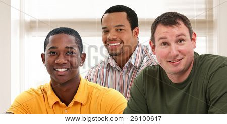 Group of attractive 30+ year old men together in office or home.