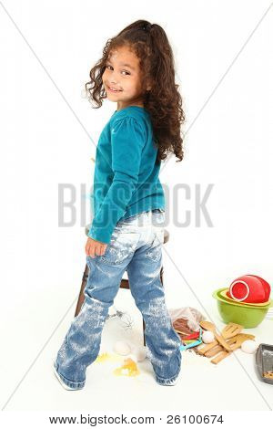 Adorable 3 year old Hispanic-African American girl, baking cookies over white background.