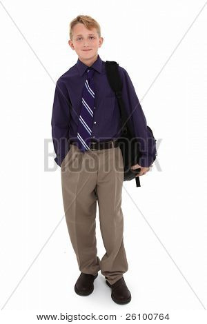 Attractive 12 year old boy in dress shirt and tie with backpack over white background.
