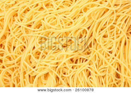 Close up texture shot of cooked spaghetti noodles plain.