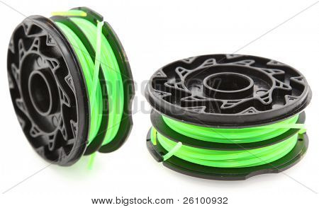 Two new replacement grass trimmer string over spools over white.