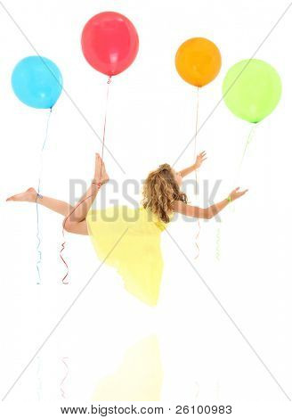 Adorable young girl child floating away on balloons with clipping path over white.