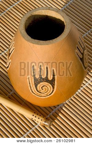 Vessel for drinking mate (gourd) and a straw (bombilla)