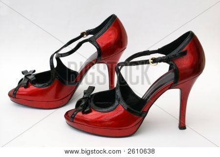 A Pair Of Red Sandals.