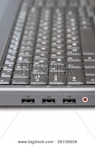Laptop keyboard in side view. Closeup.