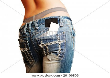 Sexy woman in jeans. There is business / credit card out of her back pocket. Grunge.
