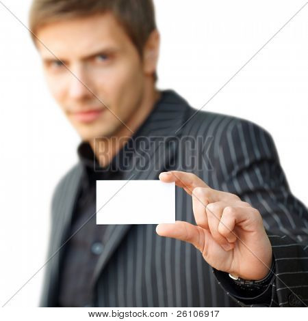 Closeup portrait shot of young businessman showing blank business card. Focus on card. Isolated.