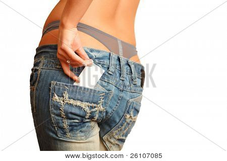Sexy woman in jeans. There is business / credit card out of her back pocket. Isolated.