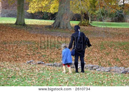 Mother And Daughter Walking Holding Hands. Parenting