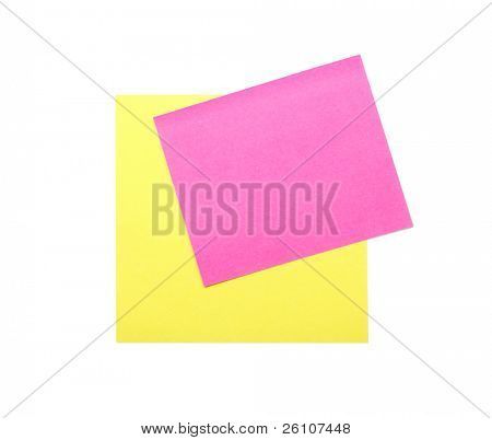 Blank yellow and pink note paper. Isolated on white. Closeup.